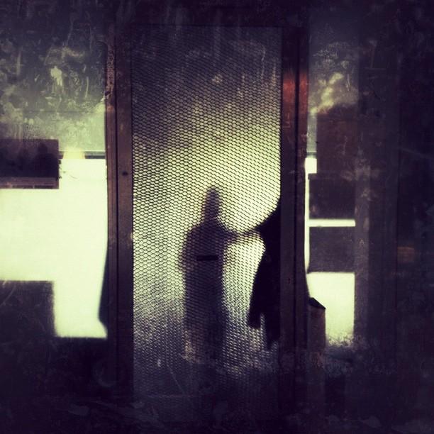 Behind the door.
